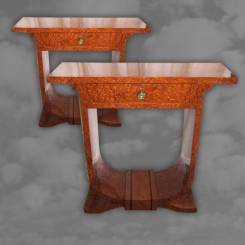 An exceptional pair of Art Deco amboyna double sided console tables