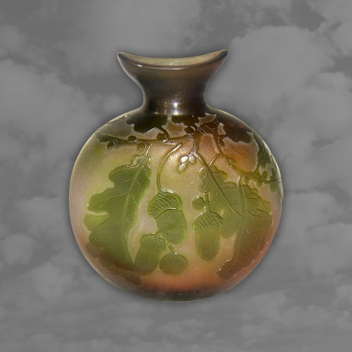 GALLE. Stunning double overlaid green cameo vase decorated with acorns
