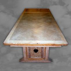 A limed oak draw leaf table with carved undercarriage