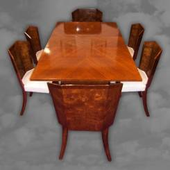 A superb English Art Deco straight grain walnut extension dining table.