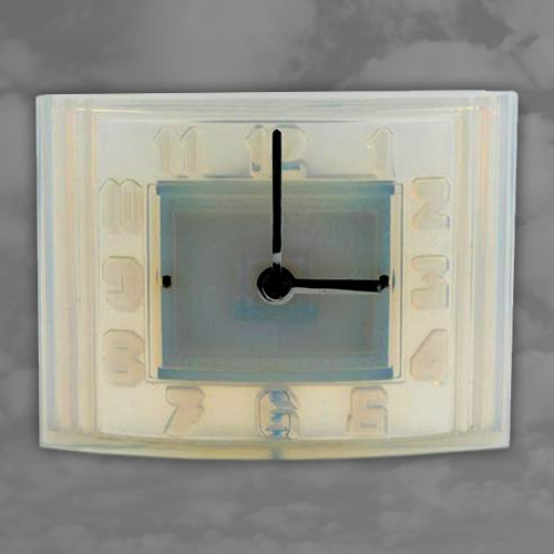 A funky ATO opalescent glass clock of domed rectangular form