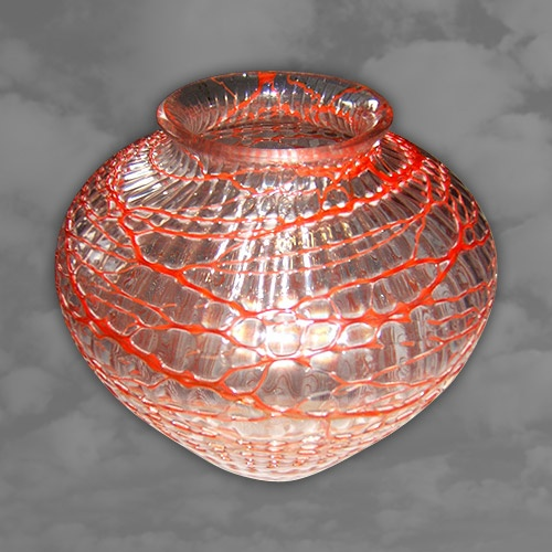 LOETZ. A most unusual glass vase with red on clear