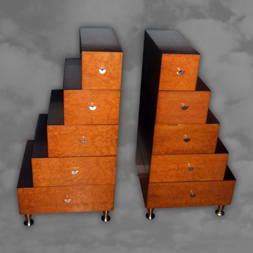 An unusual pair of stepped side cabinets