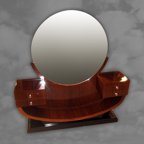 A French rosewood dressing table with circular inset mirror on ebonised plinth base