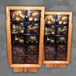 An important pair of cabinets made of satinwood