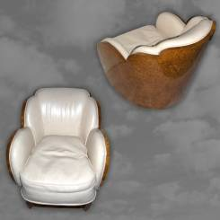 A fantastic pair of cloud shaped armchairs in satin birch