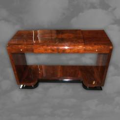 A walnut console table, the frieze drawers flanking a lift top section