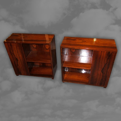 A superb pair of French rosewood asymmetric end of settee bookcases