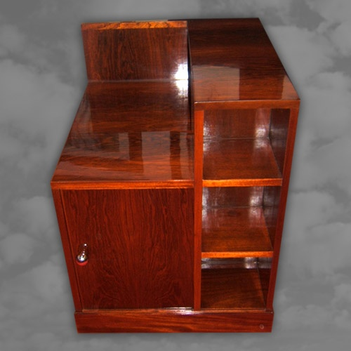 An unusual French rosewood bar of square form with asymmetrical shelf