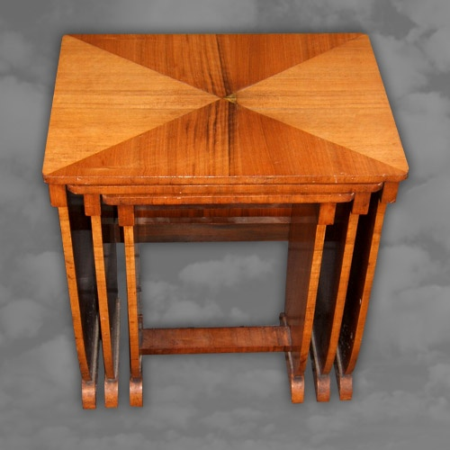 An English straight grain walnut nest of three tables