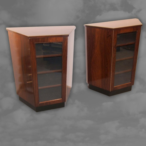 A pair of rosewood pier cabinets of canted form