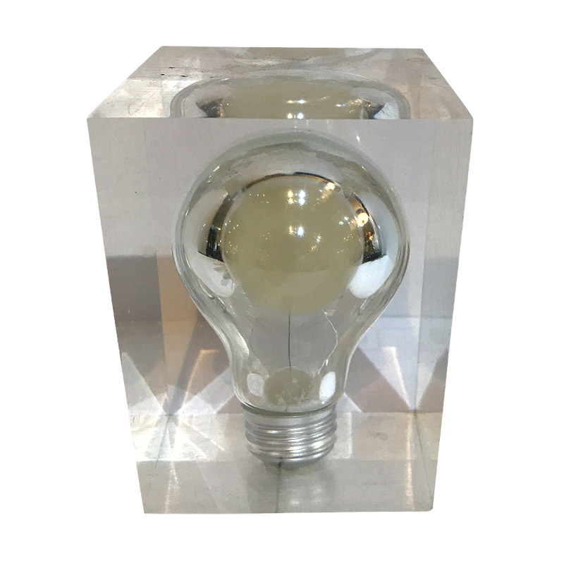 Quirky perspex sculpture containing light bulb