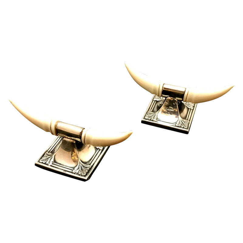 A Pair of Ivory & Silver Knife Rests