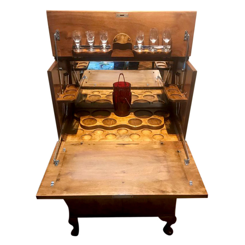 A SMART SMALL PROPORTIONED COCKTAIL CABINET