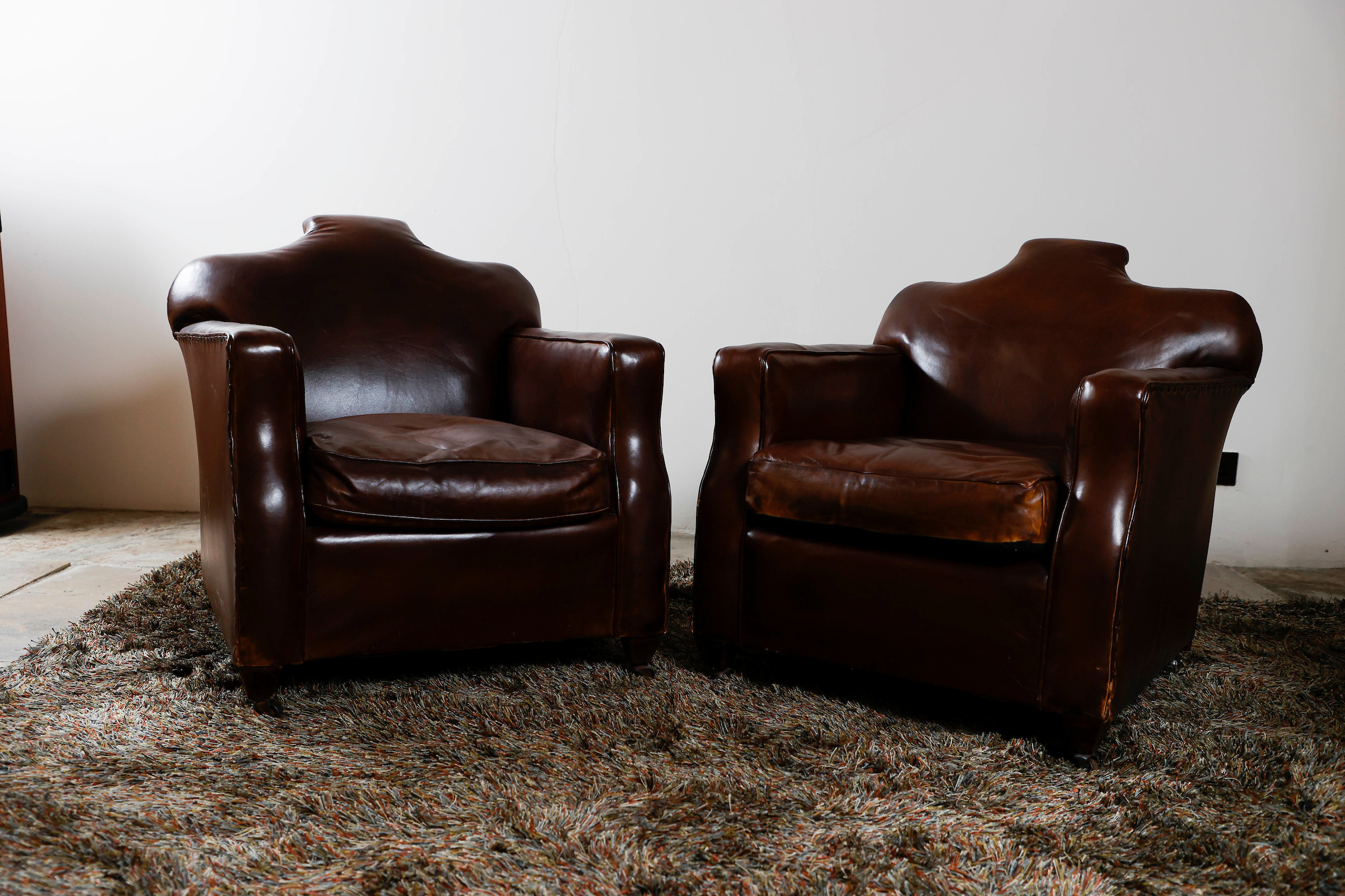 COOL PAIR OF EARLY 20th CENTURY LEATHER ARMCHAIRS