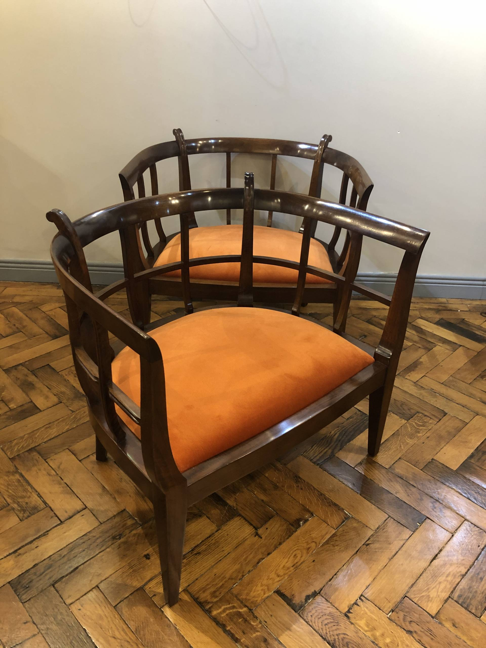 AN EXCEPTIONAL PAIR OF ARTS & CRAFTS CHAIRS