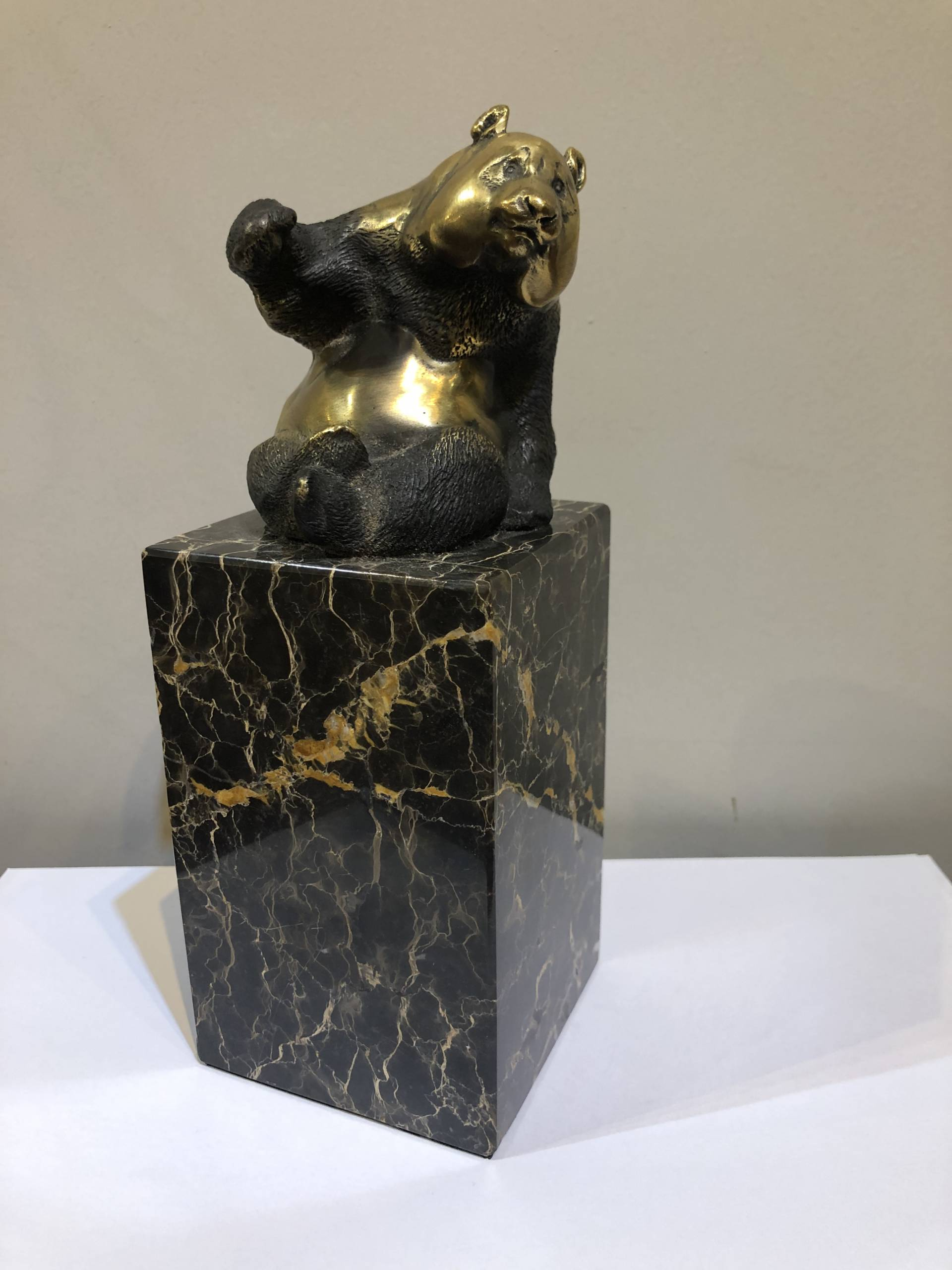 QUIRKY BRONZE BEAR SEATED ON A PORTOR MARBLE PLINTH