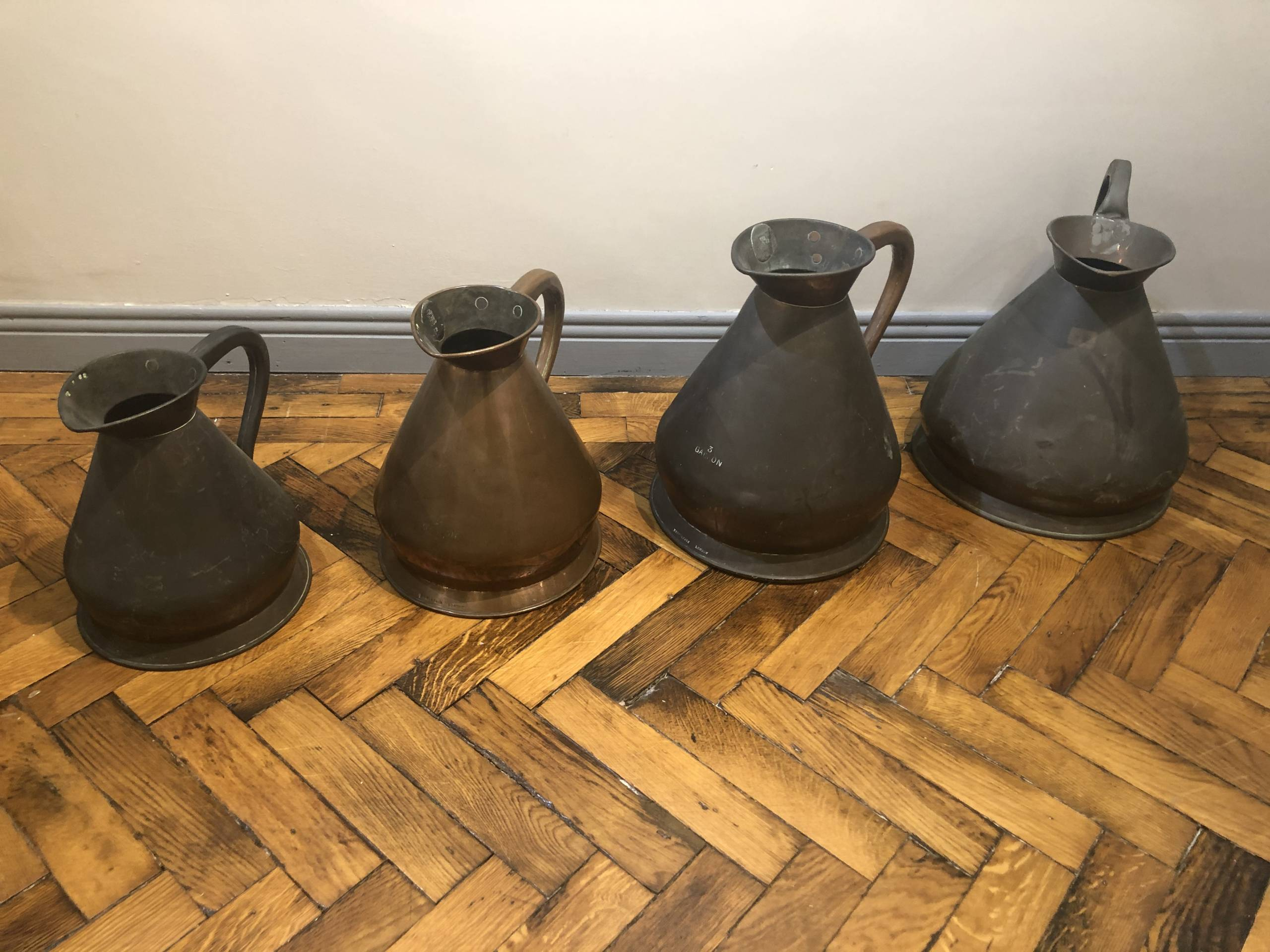A SET OF 4 GEORGIAN COPPER HAYSTACK MEASURES